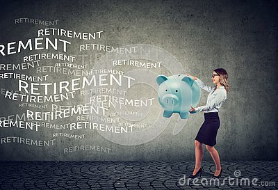 Happy young business woman attracting retirement funds with magnet piggy bank