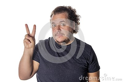 Portrait of funny fat man showing peace v-sign or victory gesture