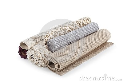 Different rolled carpets on white background