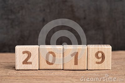 Year 2019 begin concept, simple and minimal cube wooden block bu