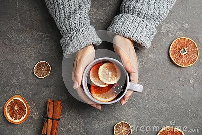 Woman in warm sweater with cup