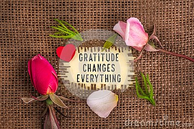 Gratitude changes everything written in hole on the burlap