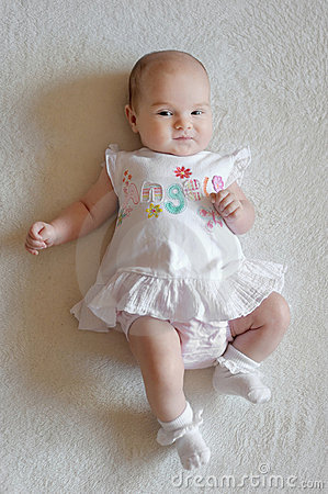 Two Month Old Baby In A White Dress