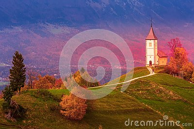 Sunset with church on top of hill, Slovenia