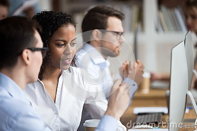Serious young African American woman talking with colleague