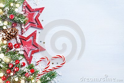 Christmas background with stars, snowy fir branches, cones and bokeh lights. Holiday banner or card