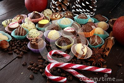 a lot of variety chocolate pralines, belgian confectionery gourmet chocolate and christmas spices with apples