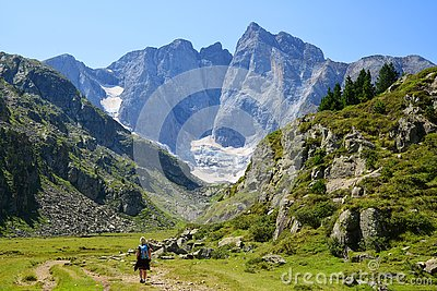 Hiker on a trek in the national park Pyrenees.Occitanie in south of France.