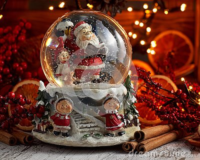 Musical Snow Globe with Santa Claus on bokeh background