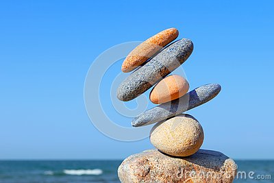 Unstable construction of multi-colored stones. The disturbed equilibrium. Imbalance concept