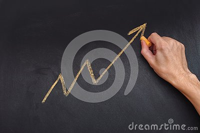 Man drawing yellow arrow showing upward trend and increasing pro