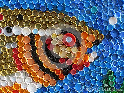 Background of plastic colorful bottle caps. Contamination with plastic waste. Environment and ecological balance. Art from junk.