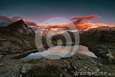 Sunset in the mountains. Small lake, even in winter, the water temperature is + 30 degrees. The Valley of Geysers.