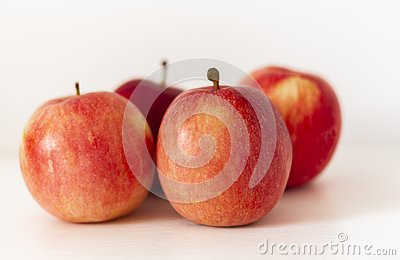 stock image of ripe red apples on a table on a white background