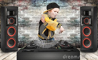 The little boy in the style of Hip-Hop .Cool rap dj. Children`s fashion.Cap and jacket. The Young Rapper.