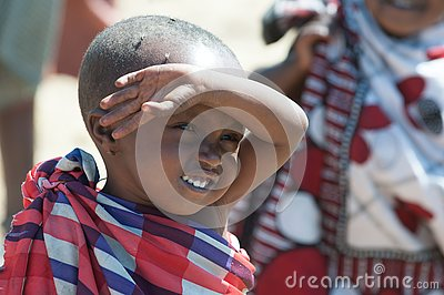 Maasai boy with eyes full of flies, Tanzania. Flies lay eggs into eyes so that the child could go blind