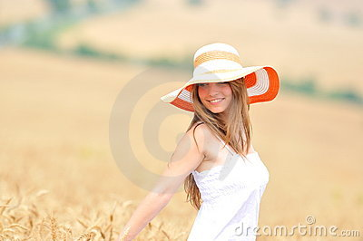 Young woman in golden wheat field