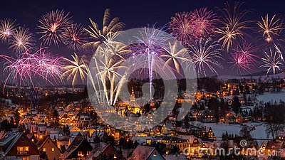 New year eve firework and Illuminated houses in Seiffen at Christmastime. Saxony Germany