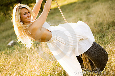 Sexy Girl Blonde on Tire Rope Swing