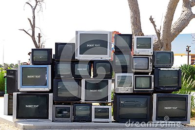 stock image of old tv s stored on the street before they go for recycling.
