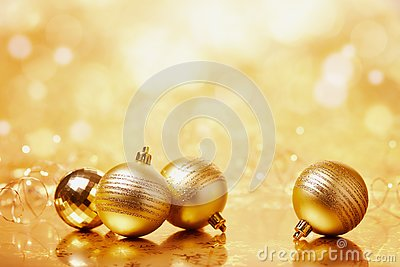 Gold Christmas balls on the shiny background