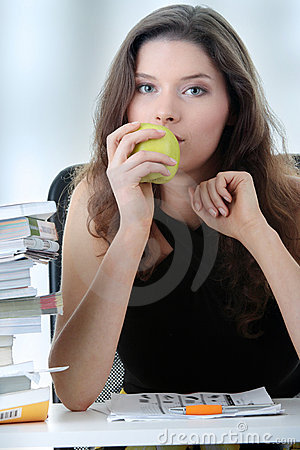 Young and pretty female student with books