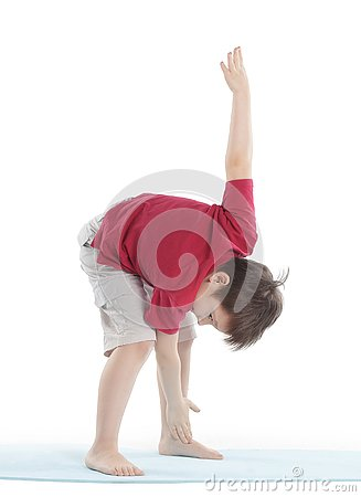 Little boy performs an exercise to stretch the muscles.isolated on white
