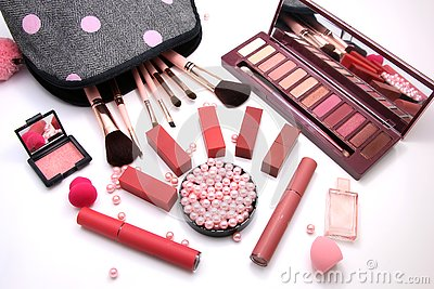 Women Make up Cosmetics bag and set of professional decorative, red lipsticks and brush makeup, perfume and sponge with pink pearl