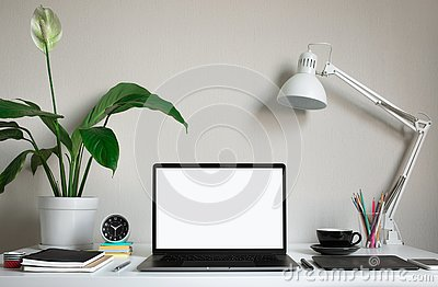 Modern work table with blank computer laptop and accessories in home office studio.Freelance designer or blogger concepts ideas
