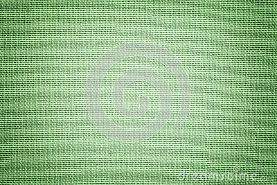 Light green background from a textile material. Fabric with natural texture. Backdrop
