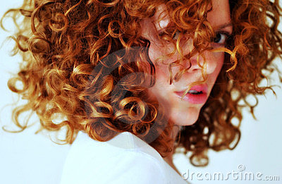 Fierce mixed young woman with curly red hair