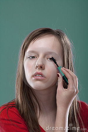 Girl putting on makeup