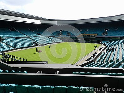 Wimbledon, United Kingdom. Gardeners working in the Centre Court.