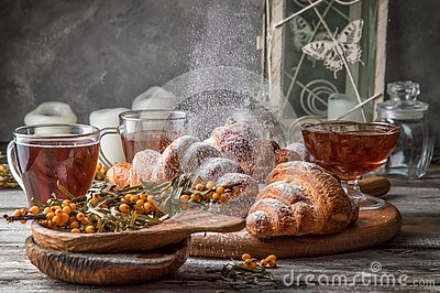 Close up. Valentine`s Day. Romantic breakfast with freshly baked french croissants, powdered on top white sugar powder