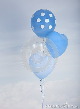 Blue balloons in heart shape and polka dot over blue sky background with retro filter effect