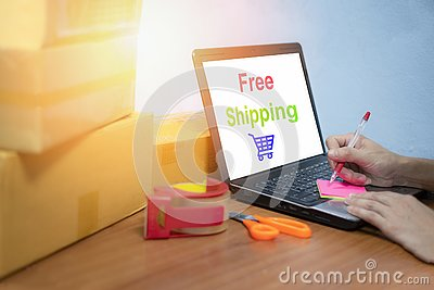 Free shipping laptop selling things online ecommerce delivery shopping online and order concept box parcels packing