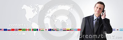 International contact us concept, businessman with mobile phone isolated on world map background, flags icons and contact symbols