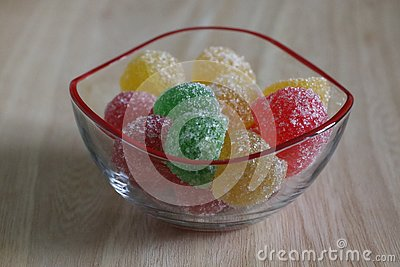 stock image of colorful marmalades in glass bowl