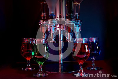 Various Drinks With Dispenser, Backlit In A Night Club