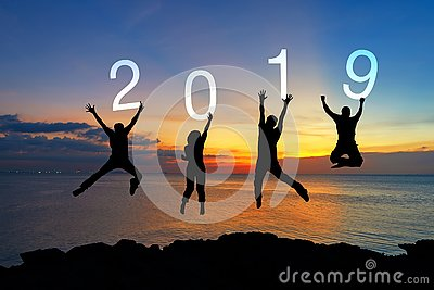 Silhouette happy business teamwork jumping congratulation graduation in Happy New year 2019. Freedom lifestyle group people jump a