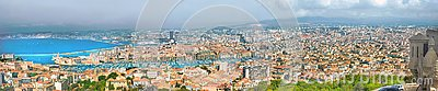 Aerial panoramic view of old port and Marseille city. France