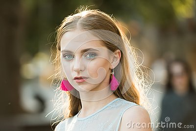 Pretty girl with fashionable hair and earrings. Beauty and fashion look of vogue model. summer fashion woman. Perfect