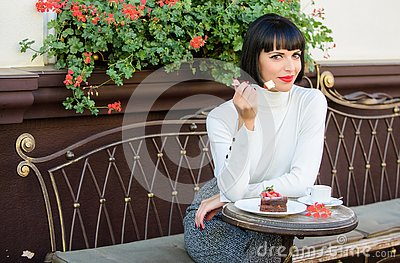 Delicious gourmet cake. Pamper yourself. Girl relax cafe with cake dessert. Woman attractive elegant brunette eat