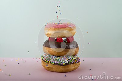 Three piled sparkled donuts