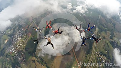 Skydivers making two circles