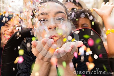 Carnaval party. Dressed group of Brazil people in the city Carnival. Brazilian woman celebrating in parade festival