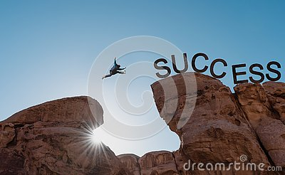 Business success, challenge, achievement and leadership concept. Silhouette a man jumping over precipice to success