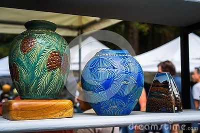 September 4, 2017 Woodside/CA/USA - Handcrafted colorful flower vases displayed at the Kings Mountain Art Fair located on Skyline