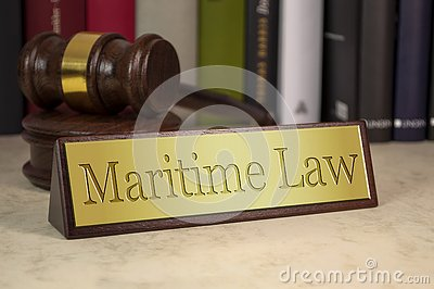 Golden sign with gavel and maritime law