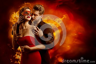 Couple Hot Flaming Kiss, Man in Love Kissing Woman in Fantasy Red Mask